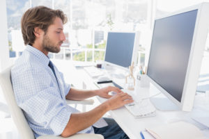 Designer sitting at his desk and working